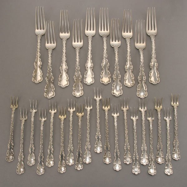1052: 21 pieces of Whiting Louis XV Sterling Flatware