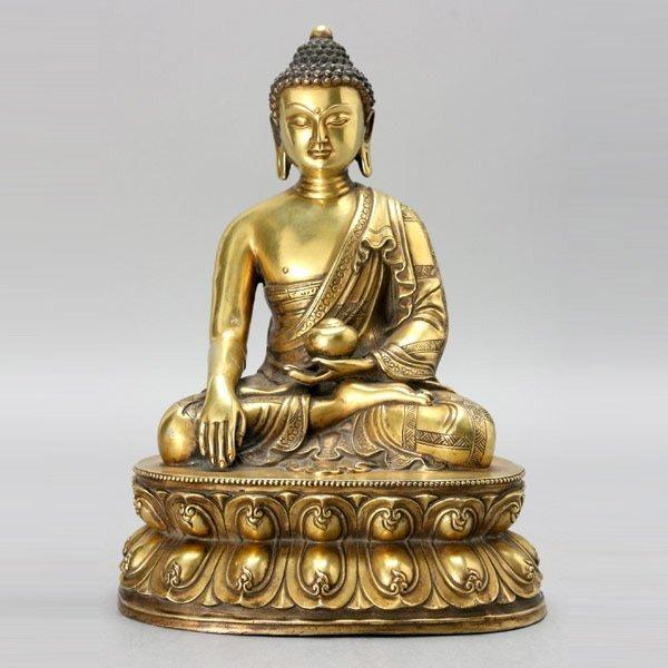 457: A Gilt Bronze Buddha