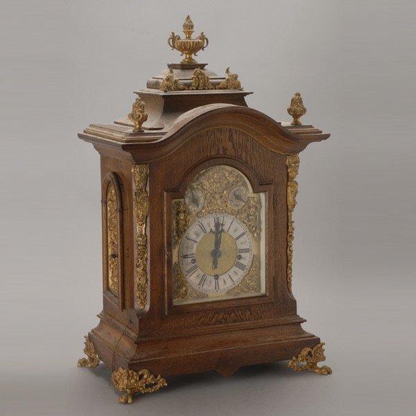 1016: English Gilt Metal Mounted Oak Bracket Clock