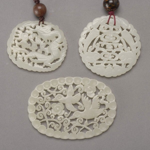 8013: Three Reticulated Jade Pendants