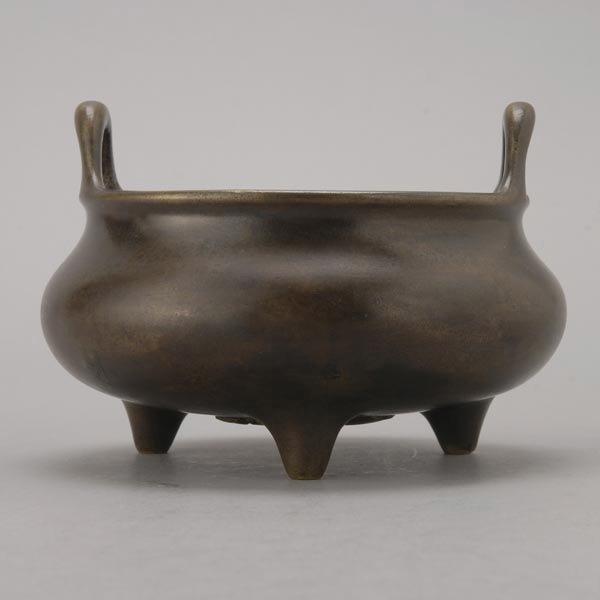 8135: A Small Bronze Tripod Censer