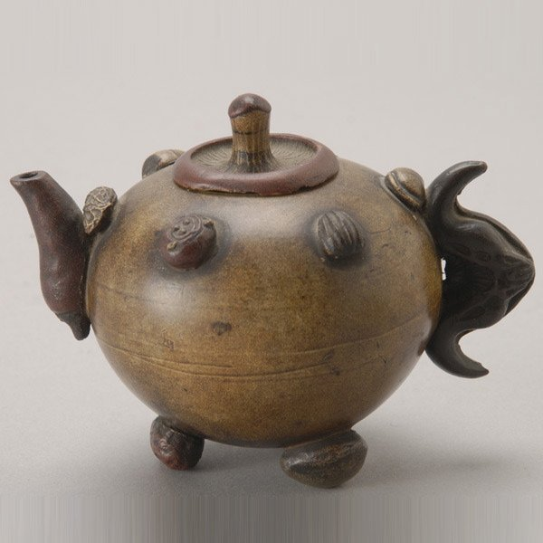 8154: A Yixing Teapot with Molded Decoration