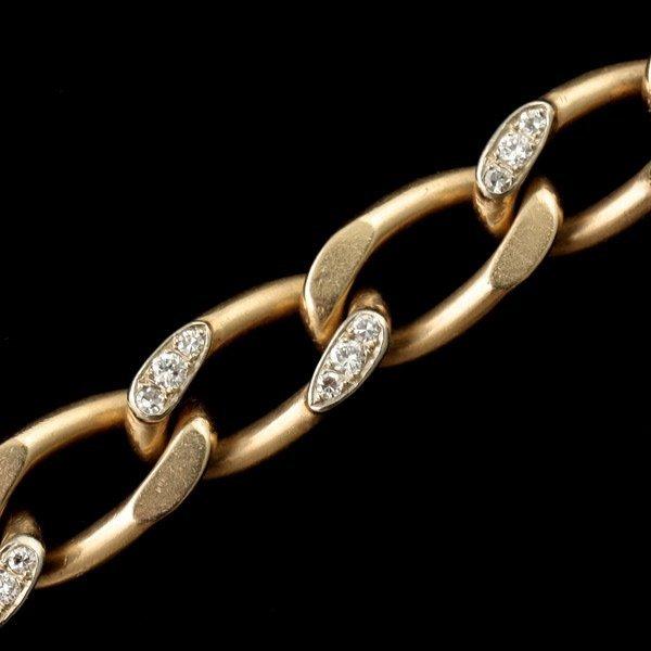 3124: DIAMOND, 14K YELLOW GOLD BRACELET.