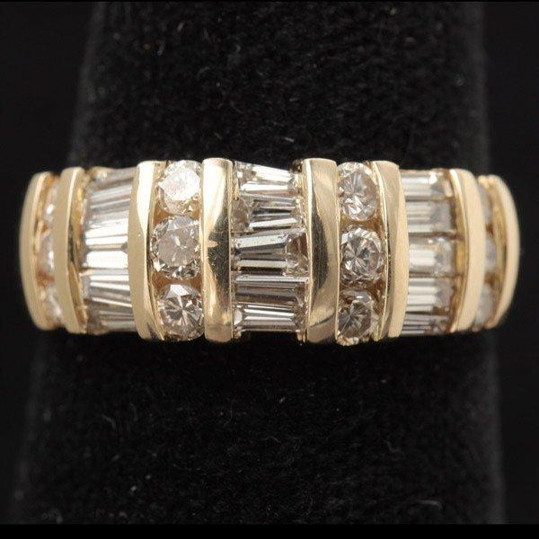 3128: DIAMOND, 14K YELLOW GOLD RING.