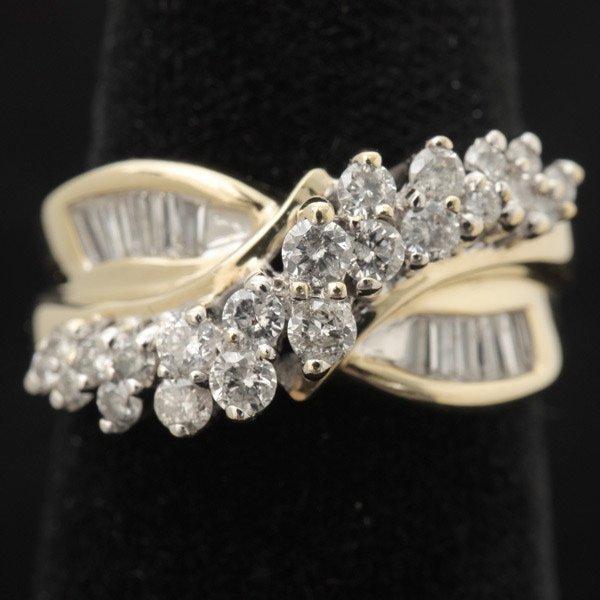 3133: DIAMOND, 10K YELLOW GOLD RING.