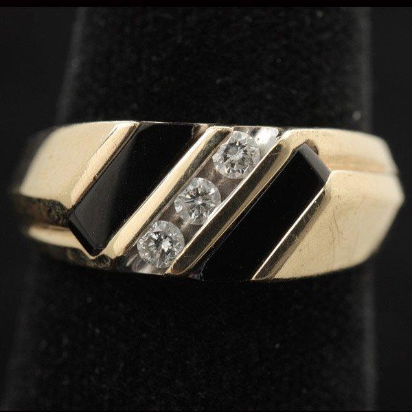 3134: BLACK ONYX, DIAMOND, 10K YELLOW GOLD RING.