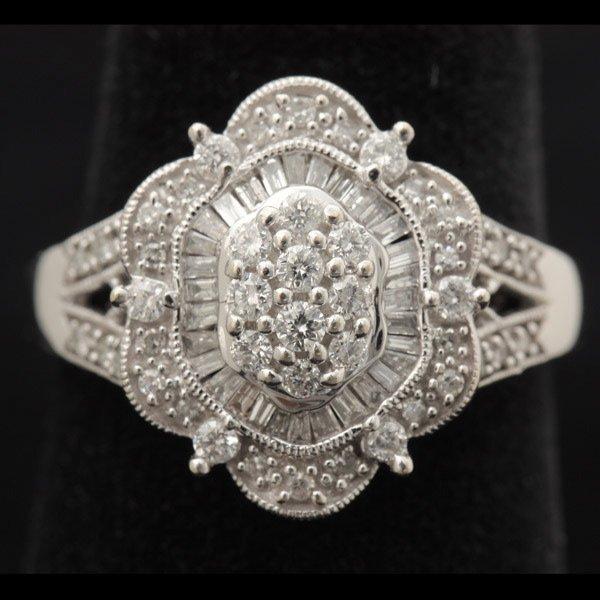 3142: DIAMOND, 14K WHITE GOLD RING.