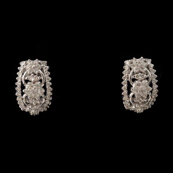 3143: PAIR OF DIAMOND, 18K WHITE GOLD EARRINGS.