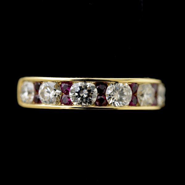 3013: DIAMOND, RUBY, 18K YELLOW GOLD RING.