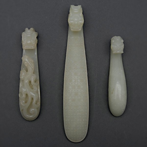 Three White Jade Belt Hooks