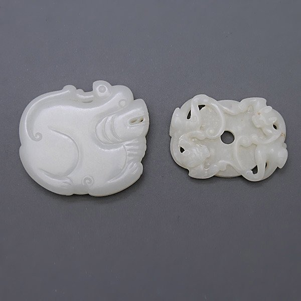 Two White Jade 'Mythical Beast' Pendants