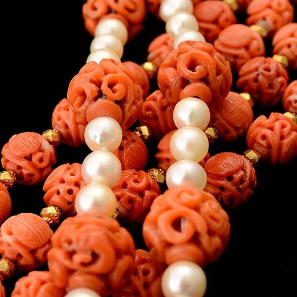 TWO CORAL BEAD, CULTURED PEARL, 14K GOLD NECKLACES.