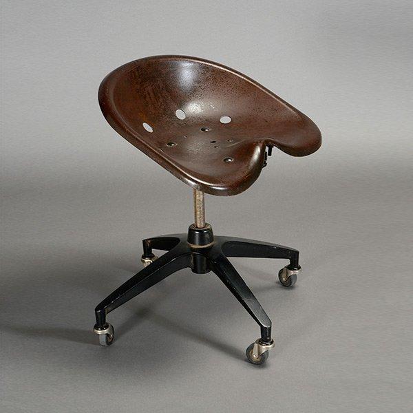 Vintage Industrial Modernist Saddle Seat Rolling Stool.