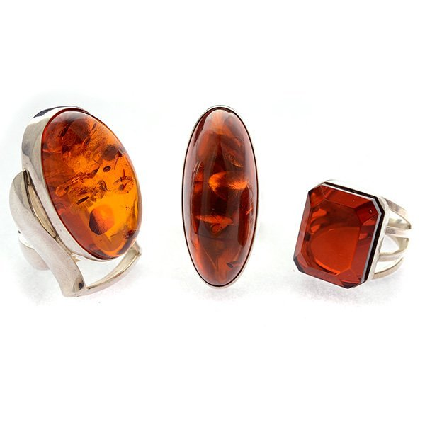 Collection of Three Amber, Sterling Silver Rings.