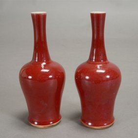 A Pair Of Small Oxblood Gooseneck Vases