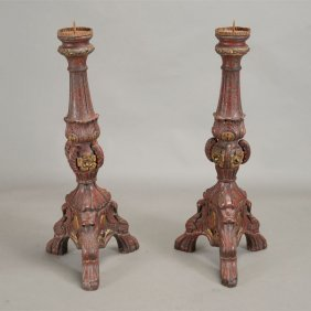 Pair Of Italian Red Painted Parcel Gilt Pricket