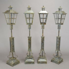 Four Wrought Iron And Tole Floor Lanterns