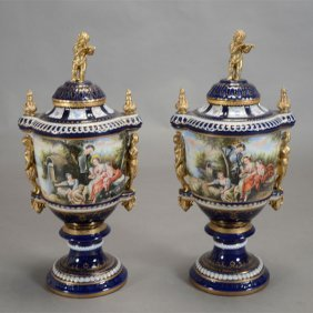 Pair Of Sevres Style Porcelain Urns With Putti Finials