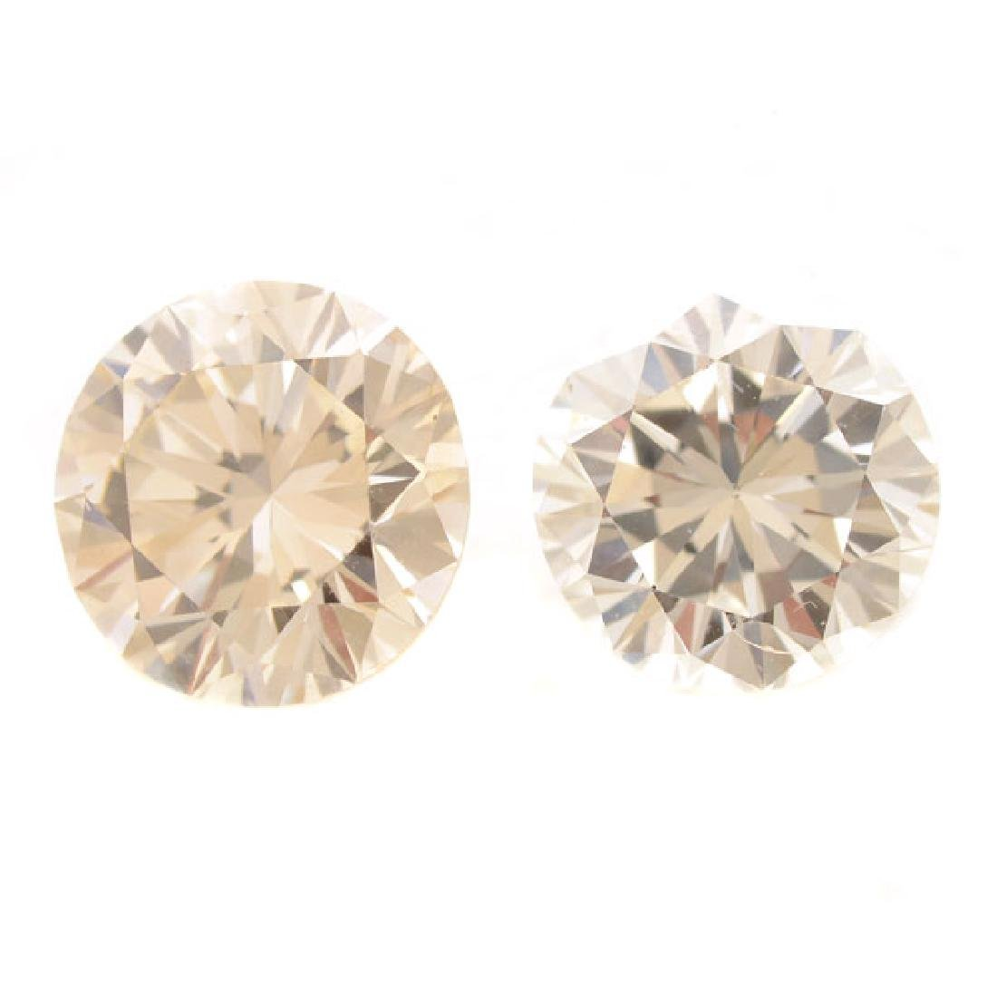 Collection of Two Unmounted Diamonds.