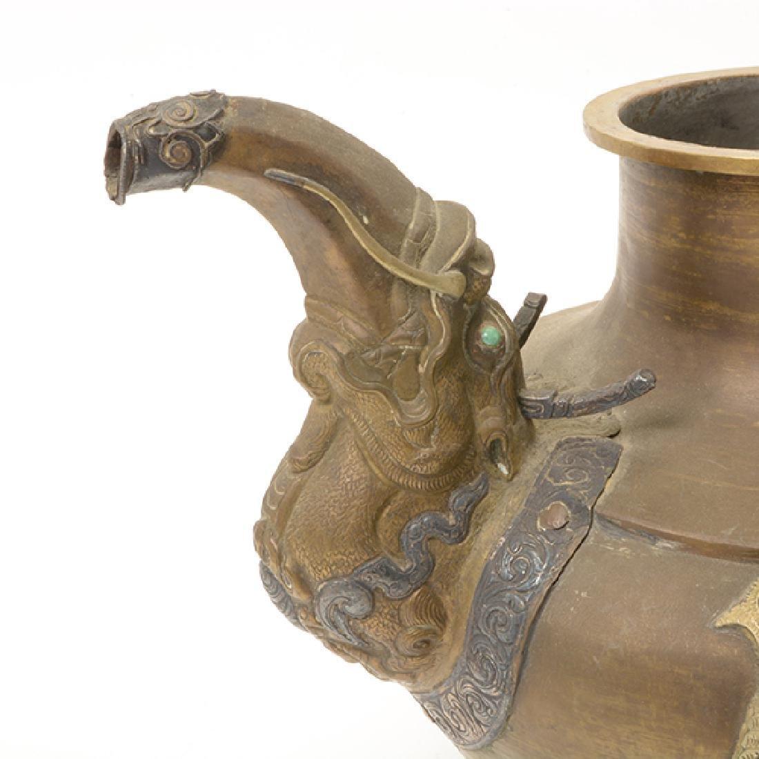 A Tibetan Gilt Copper Ewer - 7