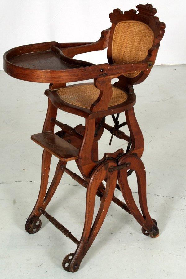 "2: Antique Oak Childs Highchair/Stroller 37""h x 14 1/2"""