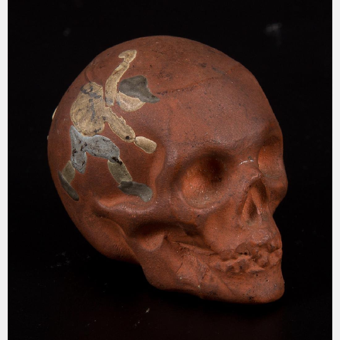 A Weller Pottery Red Clay Souvenir Skull from the