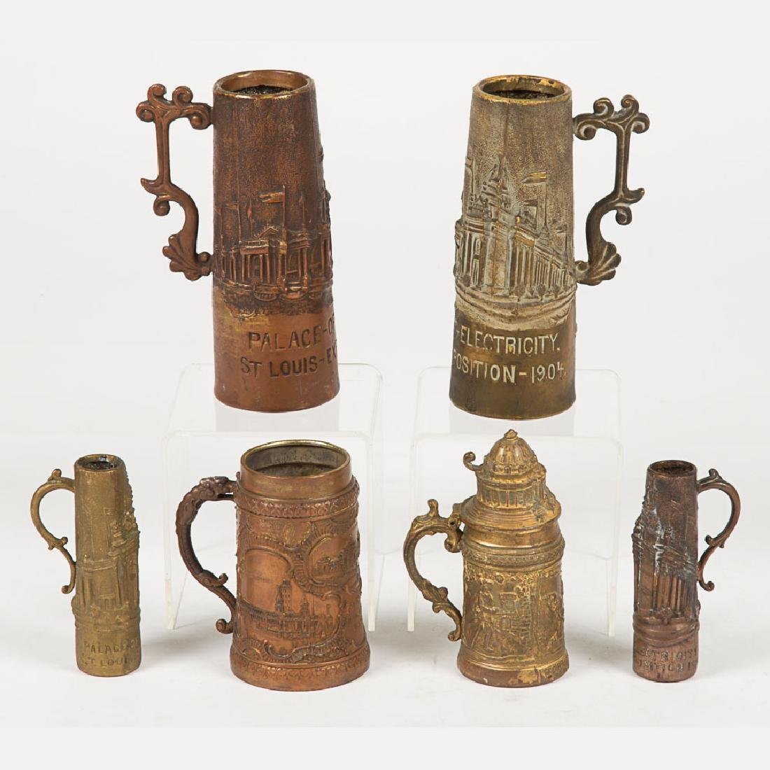 A Group of Six Base Metal Tankards and Steins from the