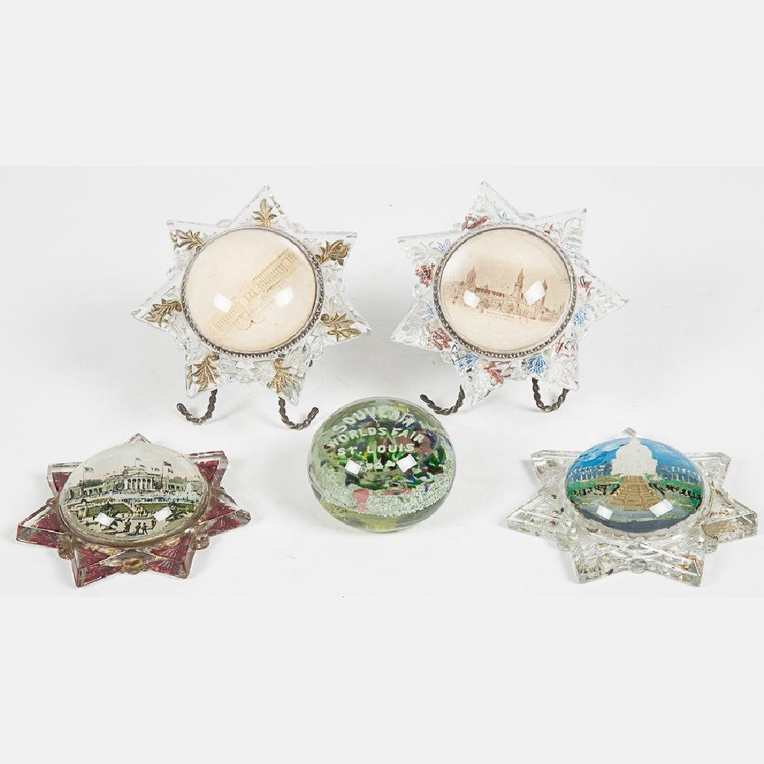 A Group of Five Glass Paperweights and Souvenirs by