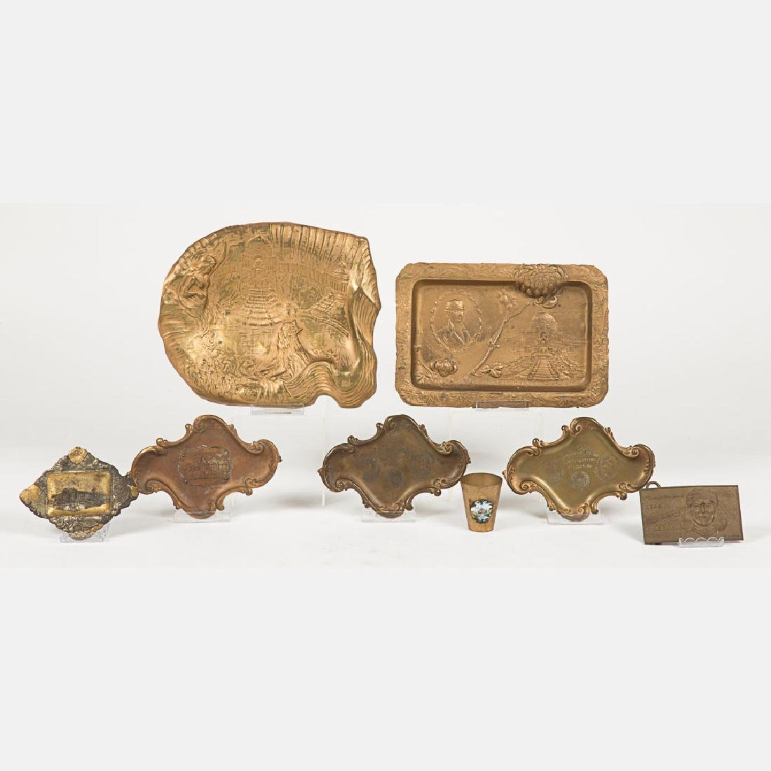 A Group of Six Metal Souvenir Trays from the Louisiana
