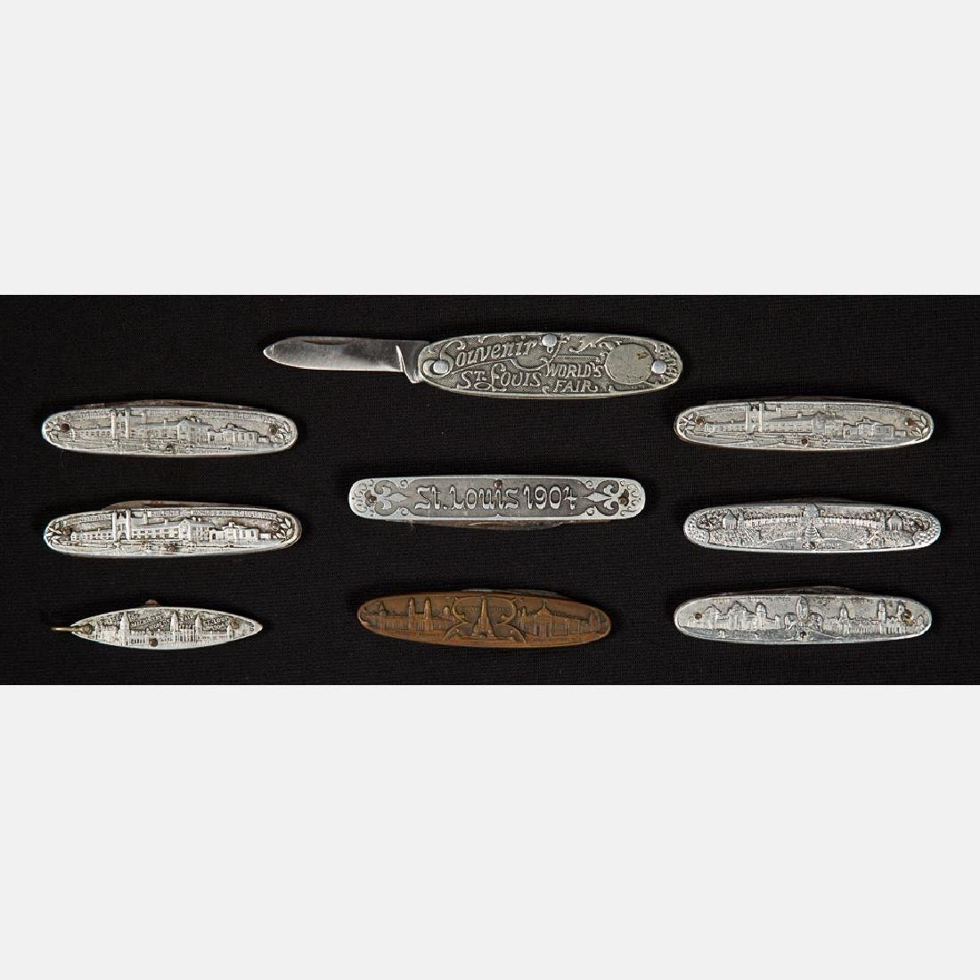A Group of Nine Aluminum and Brass Pocket Knives from