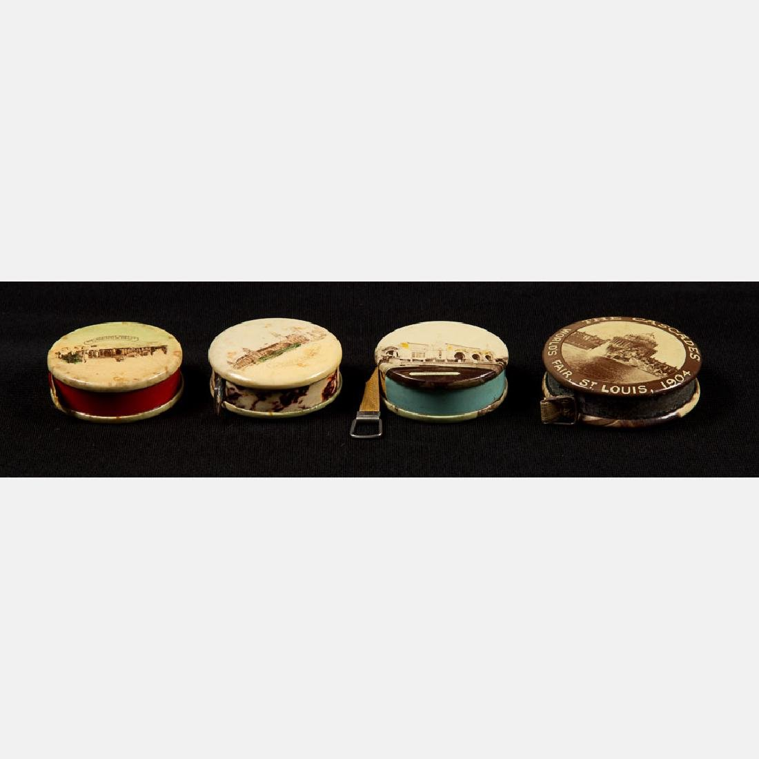 A Group of Four Multicolored Celluloid Measuring Tapes