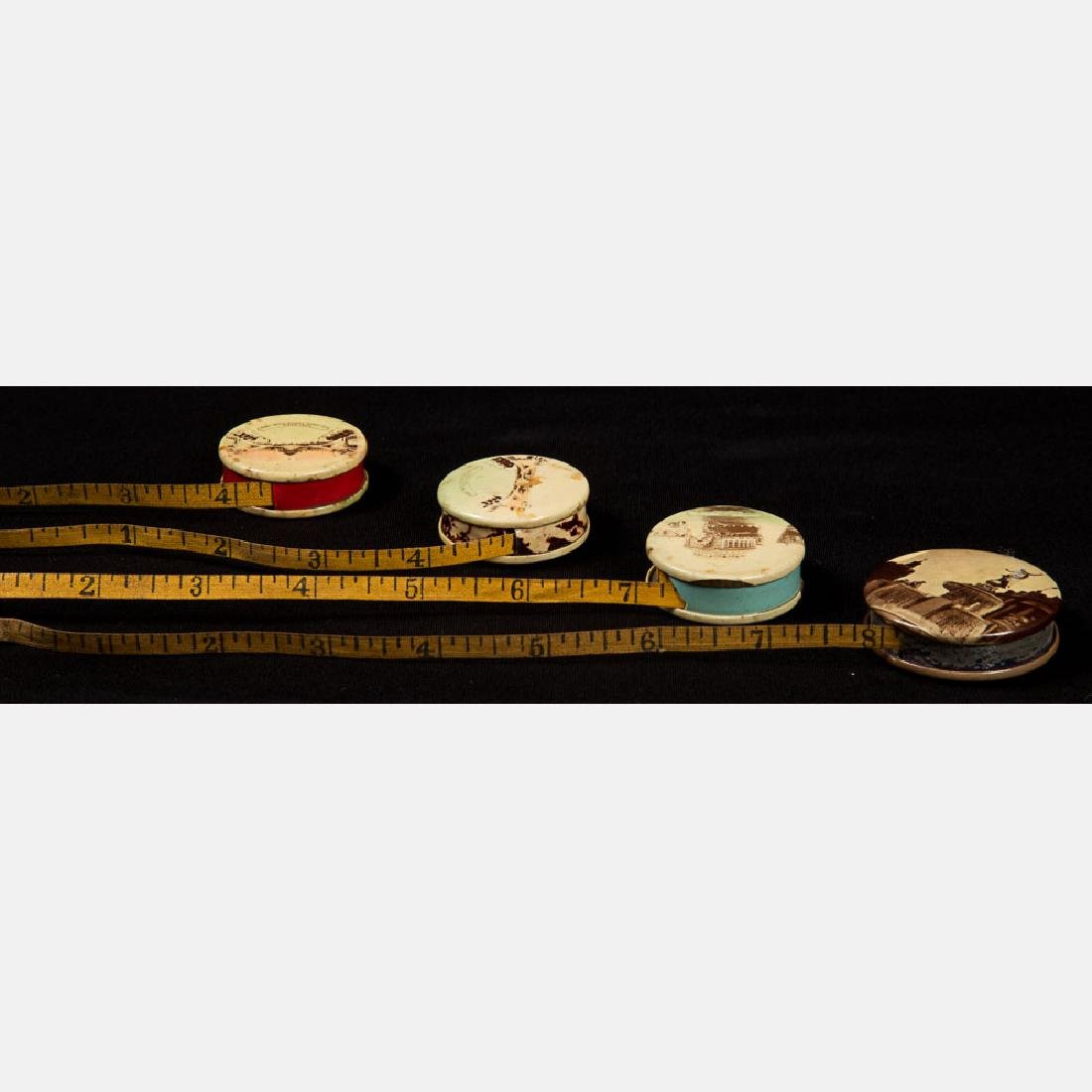 A Group of Four Multicolored Celluloid Measuring Tapes - 4
