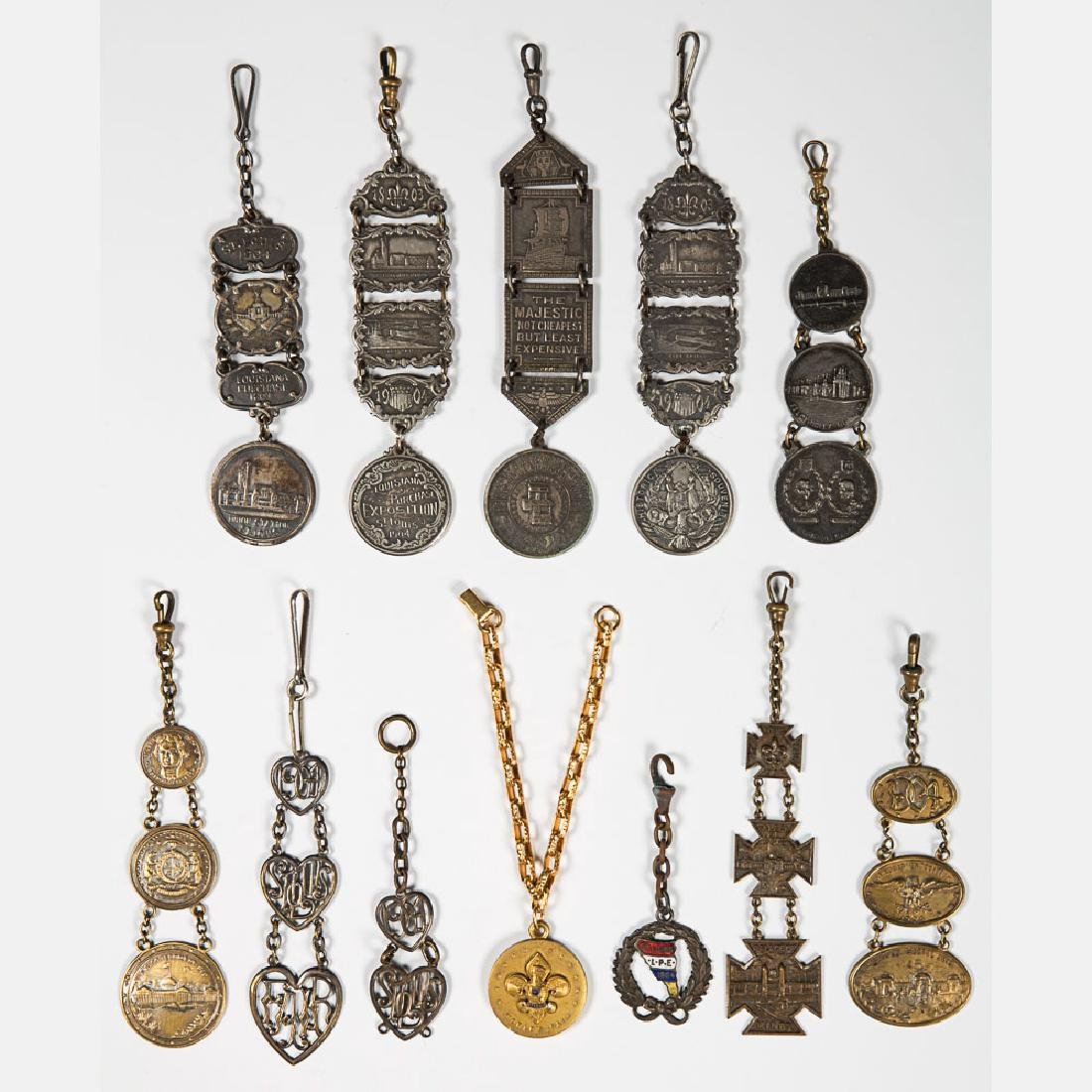 A Collection of Twelve Metal Souvenir Fobs from the