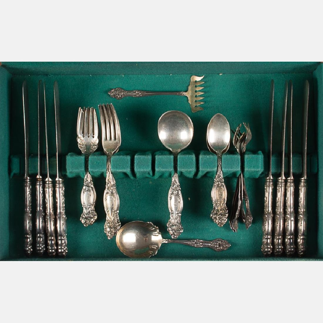 A Set of Sterling Silver Flatware Service by Simpson,