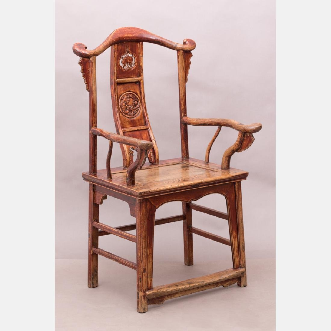 A Chinese Hong Mu Style Carved Elm Armchair, 20th