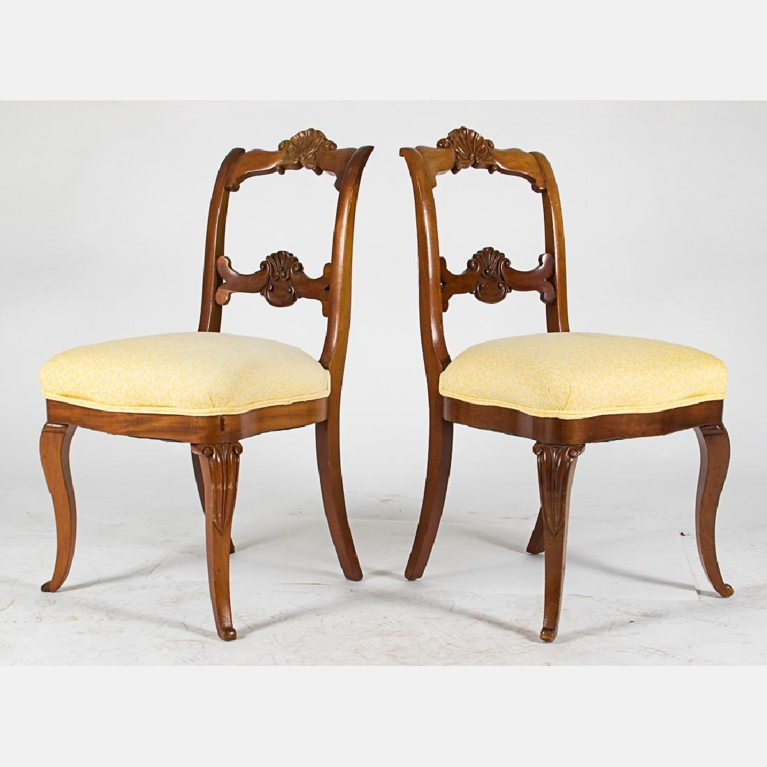 A Pair of Victorian Carved Mahogany Side Chairs with