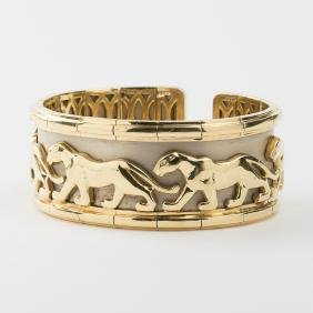 An 18kt. Yellow and White Gold Panther Motif Cuff