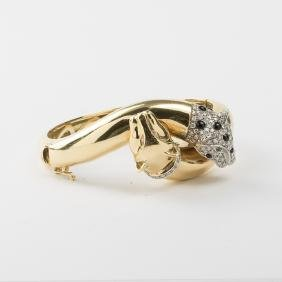 An 18kt. Yellow and White Gold, Diamond, Emerald and