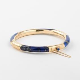 A 14kt. Yellow Gold and Lapis Lazuli Bangle Bracelet.
