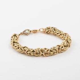 A 14kt. Yellow Gold Circular Link Bracelet.