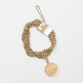 A 10kt. Yellow Gold Circular Link Bracelet with a 14kt.