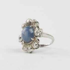 A 14kt. White Gold, Star Sapphire and Diamond Ring,