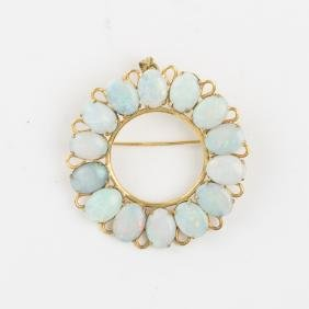 A 10kt. Yellow Gold and Opal Brooch,
