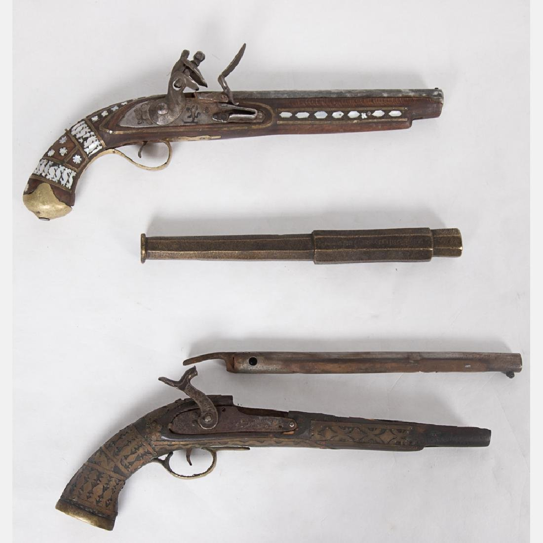 Two Afghan Flintlock and Percussion Pistols,