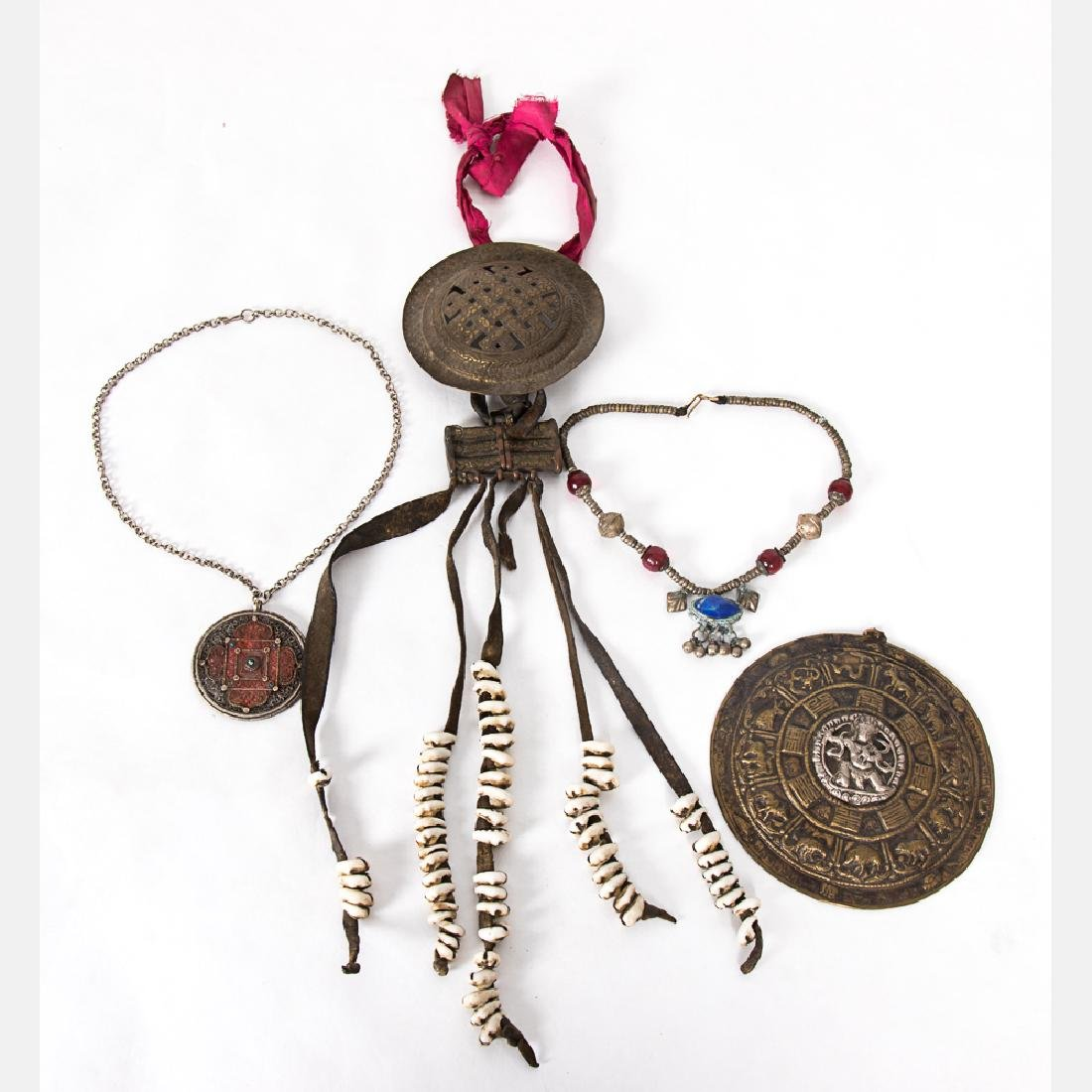 A Collection of Tibetan Silvered Metal, Brass,