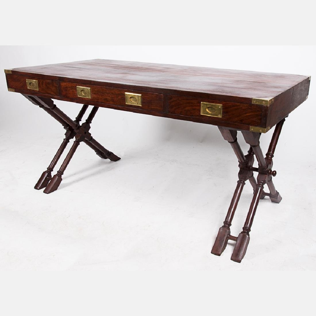 A Campaign Style Mahogany and Brass Desk, 20th Century.