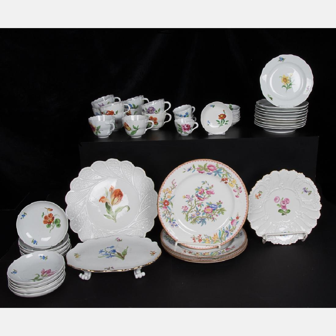 A Partial Set of Meissen Porcelain Cups and Saucers,