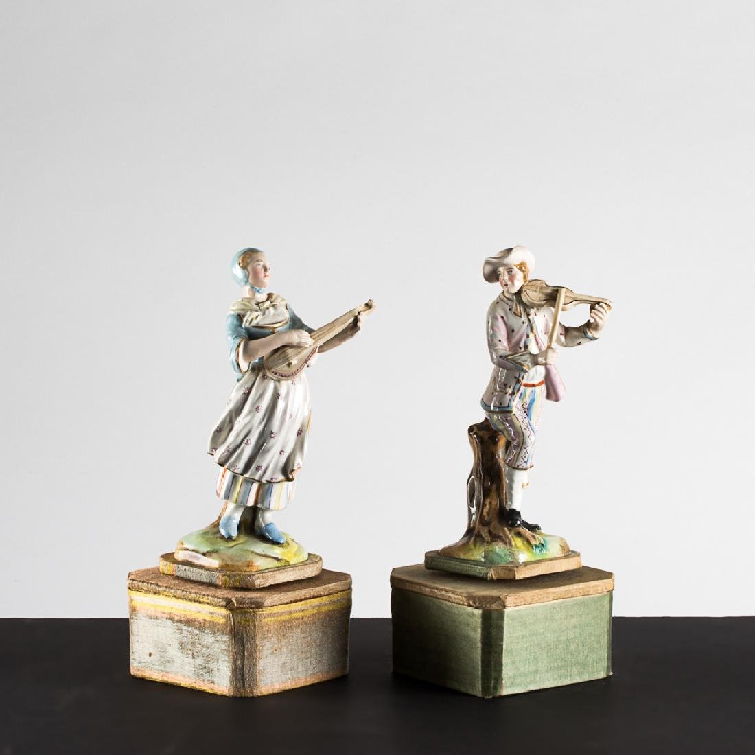 A Pair of French Porcelain Automatons Depicting a Male