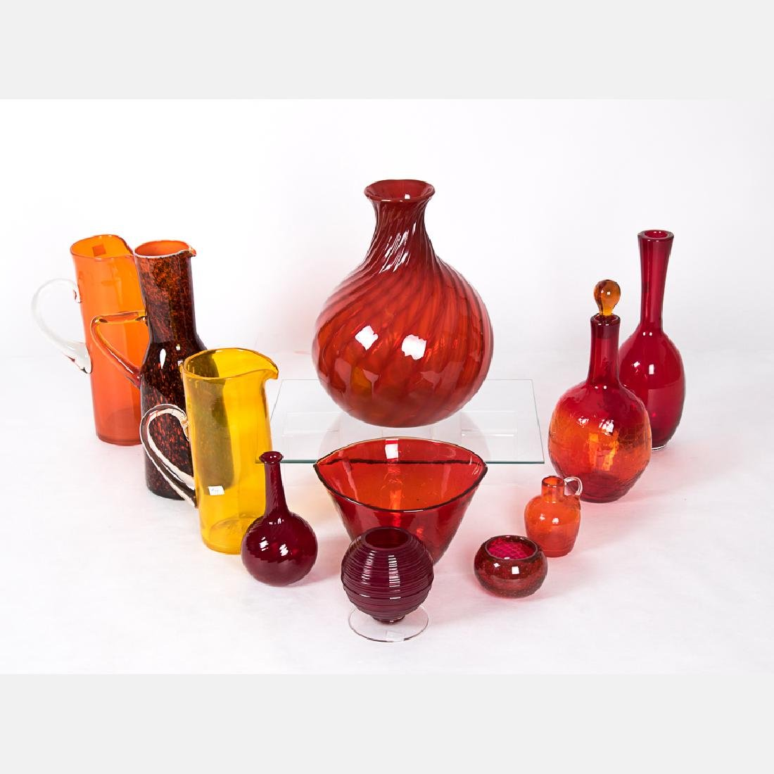 A Collection of Blown Colored Glass Serving and