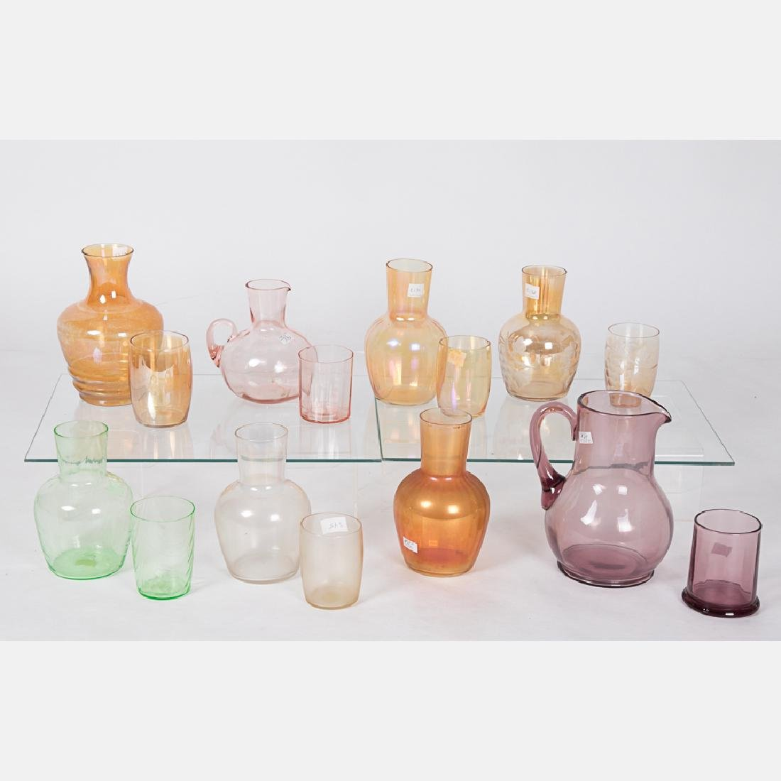 A Collection of Colored Blown Glass Tumble-Ups by